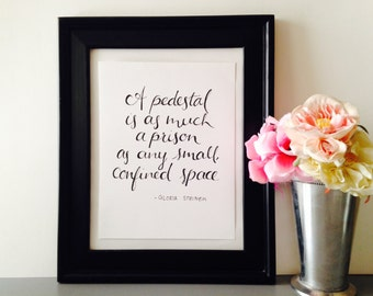 Inspirational calligraphy quote: A pedestal is as much a prison as any small, confined space- Gloria Steinem, rosegold foil, gold foil