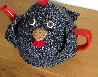 Hand-knitted speckled hen tea cosy.