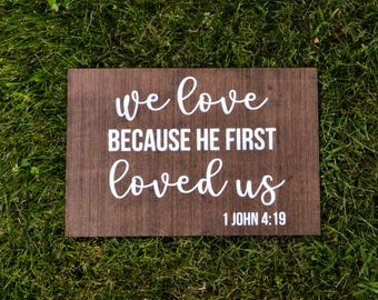 "Wooden ""He First Loved Us"" Sign"
