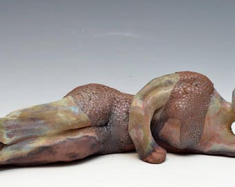 Abstract Reclining Buddha Figure at Rest in Raku Ceramics