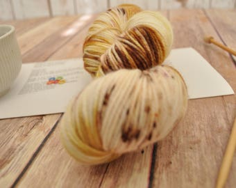"Hand-dyed yarn, ""Praline Crunch"" Variegated, soft and squishy yarn. Great for socks or shawls. 80/20 Superwash wool/Nylon"
