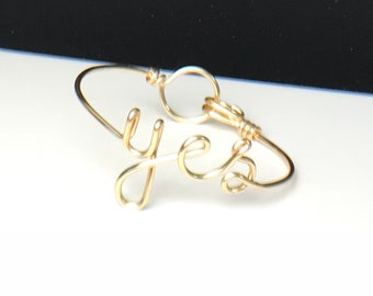 "yes bracelet. she said yes bracelet. Rose Gold ""yes"" Bracelet silver plated. Bangle Bracelet. She said yes, I said yes"