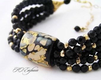 "Braceletes Black Agate Lampwork beads ""Gold sparks"""