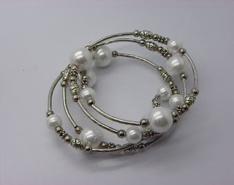 Bracelet 4 row memory wire and White Pearl beads 12 mm mother of Pearl