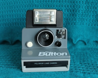 "Polaroid ""The Button"" sx-70  camera"