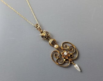 Antique Edwardian 10K gold diamond and seed pearl long drop lavalier pendant necklace