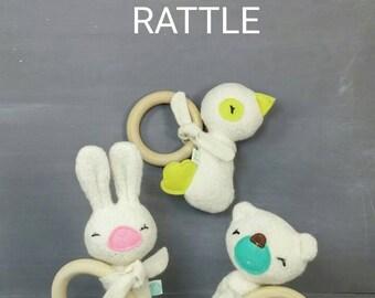 Organic teething rattle. Baby toy, rattle, gift