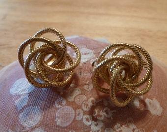 Gold swirl clip earrings (C113)