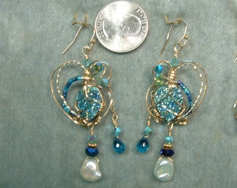 Cassiopea Seas Earrings with embellishments.