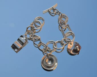 Sterling silver charm bracelet with book, cup of tea & gold egg on toast