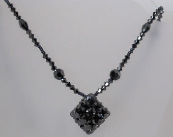 Crystal necklace of Swarovski hematite 2x with a cube.