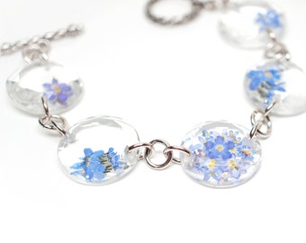 Blue 'Forget-me-not' flower on faceted crystal linked bracelet - white gold plated silver - real pressed flower