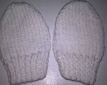 Pair of handknit baby mittens or bootees (0-6 months)
