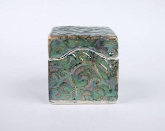 Small ceramic box, seafoam green with indigo pigment under, slab built, porcelain, handmade pottery, swirley pattern