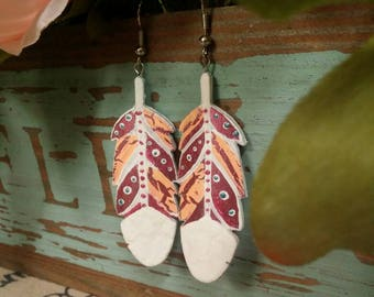Fun, Flirty Boho Feather Earrings. Metallic Pink. White and blue accents. Super lightweight but strong!