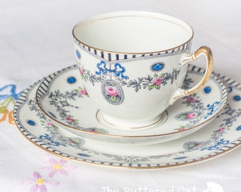Stylish antique English tea trio, blue ribbon bows, rose cameos, swags and garlands