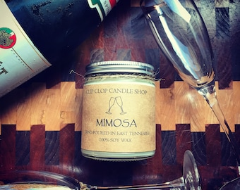 Mimosa >>--> All Natural Soy Wood Wick Candle >>--> Notes of fresh orange juice and champagne