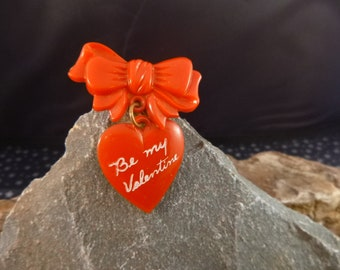 Bow and Heart Vintage 1950s Celluloid Be My Valentine Pin | Red Valentine Heart Dangling from Bow |  Mid Century Red Heart Pin | Book Piece