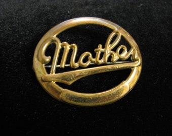 "antique gold toned ""MOTHER"" brooch"