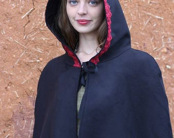 Black Cape with hood lined with red lace or trim Cape Diem