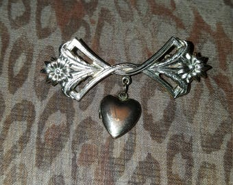 Lillian Vernon gold tone pin with heart locket charm