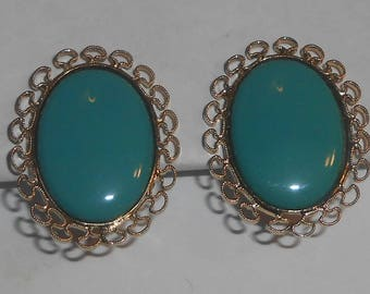 Vintage LEWIS SEGAL Gold Tone Filigree Surrounding an Oval Turquoise Blue Glass Cabochon Clip On Earrings
