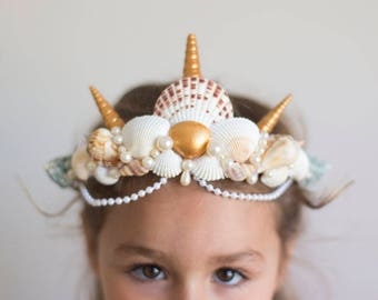 Child's mermaid crown with seashells and glass pearls in ivory, gold, mauve, and green.