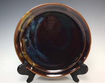 Handmade, stoneware, dinner plate. Rich browns and multi-color accents on plate
