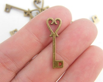 14 Key pendants antique bronze tone K81
