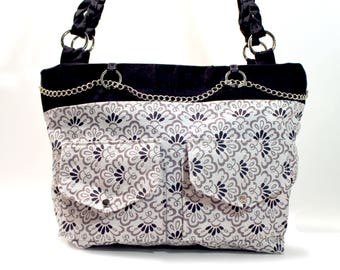 Fabric small purse, handbag, shoulder bag, black and white, patterned, with fabric handle and chain, front pockets, zipper closure