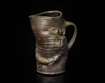 Wood fired stoneware vessel, maimed jug, vase