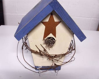 blue and white birdhouse
