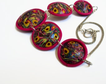 Psychedelic circles in a handmade necklace