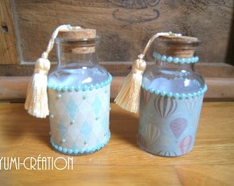 Pair of little blue bottles with PomPoms