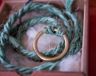 The Grateful String is made of baling twine and a ring on a bed of wool from my sheep.  Pull on the string and be Grateful.