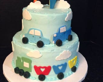 Trains, planes and cars cake topper