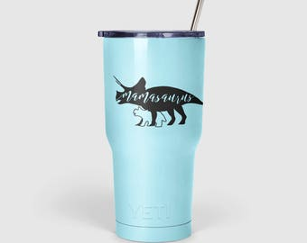 Mamasaurus Vinyl Decal Sticker - Triceratops Dinosaur with Baby Dino Silhouette, hand-lettered, perfect for tumbler, mug, phone, car window