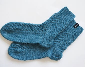 Knitted socks made wool and alpaca with cables