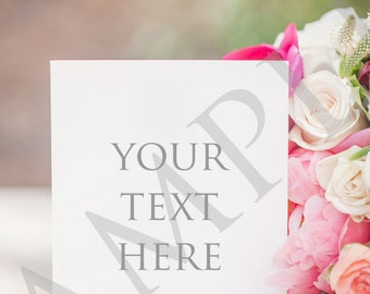 Colorful blank invitation stationery with pink and orange bouquet stock photo