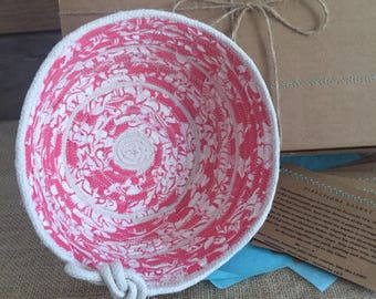 Pink hand woven fabric, coiled rope basket with love knot detail