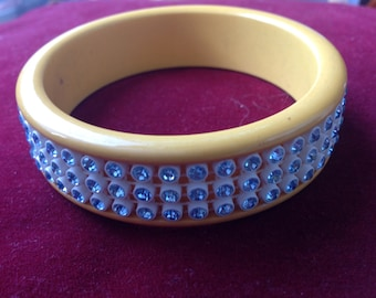 Vintage yellow Bakelite bangle bracelet with light blue rhinestones