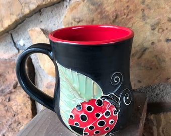 Lady Bug mug handmade thrown pottery slip trailed red and black w/green leaves 2