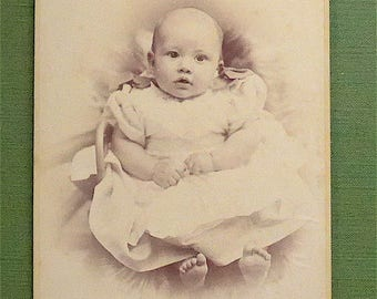 Cabinet card, antique.  Featuring a baby with an alert expression.  J. Fisher, 90 Golborne Rd. North Kensington. 1890's.
