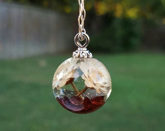 White star daisies and garnet gemstones orb pendant