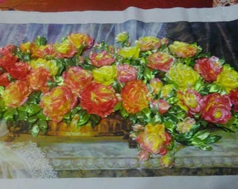 Painting embroidered silk ribbons. Manual work