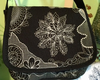 Handmade, embroidered, quilted, lined pocketbook that can be Monogrammed