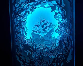 Underwater hand cut paper lightbox