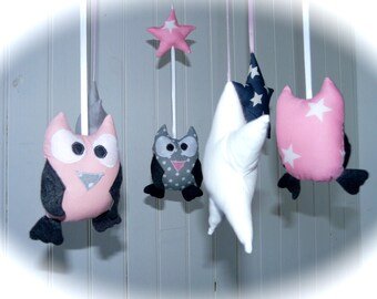 Light pink and grey mobile owls and stars