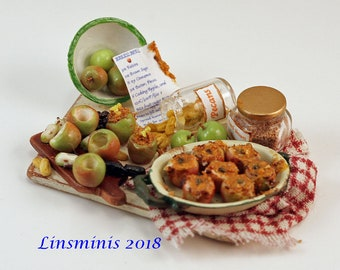 """12th scale handmade dollhouse miniature """"Making Baked Apples""""."""