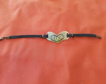Bronze heart bracelet with black suede strap